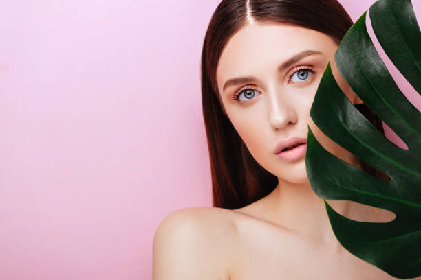 Beauty Woman with natural green palm leaf Portrait stock photo