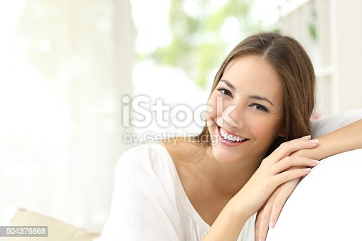 istock Beauty woman with white smile at home 504376668
