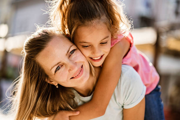 Beauty women carry small girl on the back Portrait young women and cute girl hugging mother and child stock pictures, royalty-free photos & images