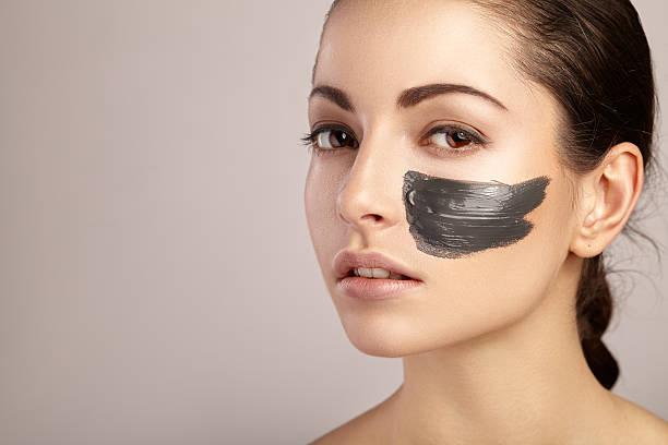 Beauty women getting facial mask stock photo