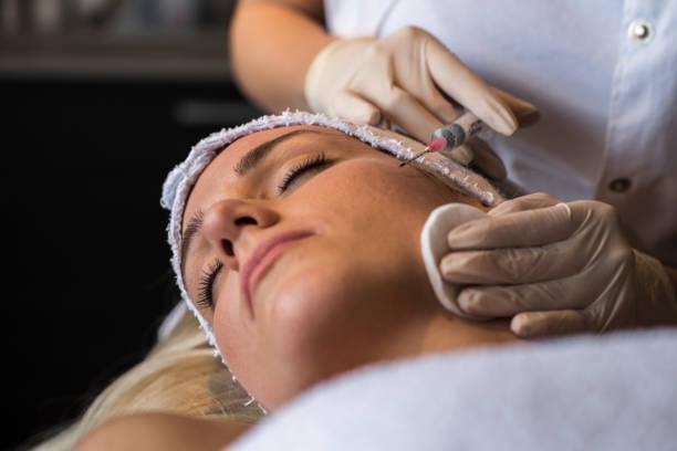 Beauty women having botox treatment stock photo