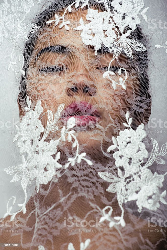 beauty young afro woman through white lace stock photo