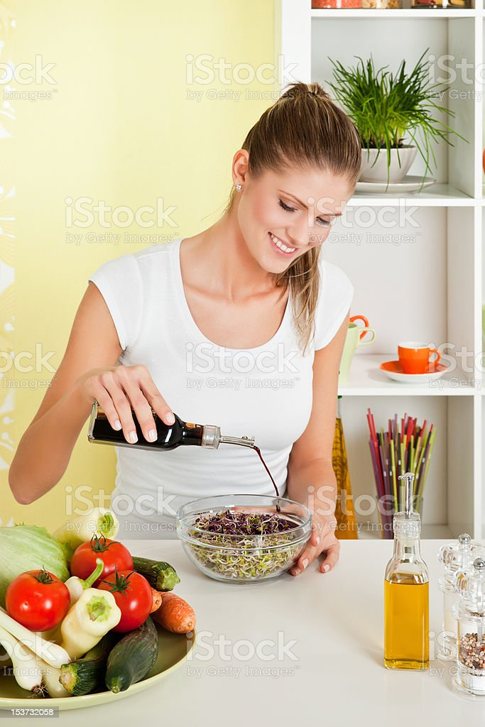 Beauty, young girl making salad royalty-free stock photo