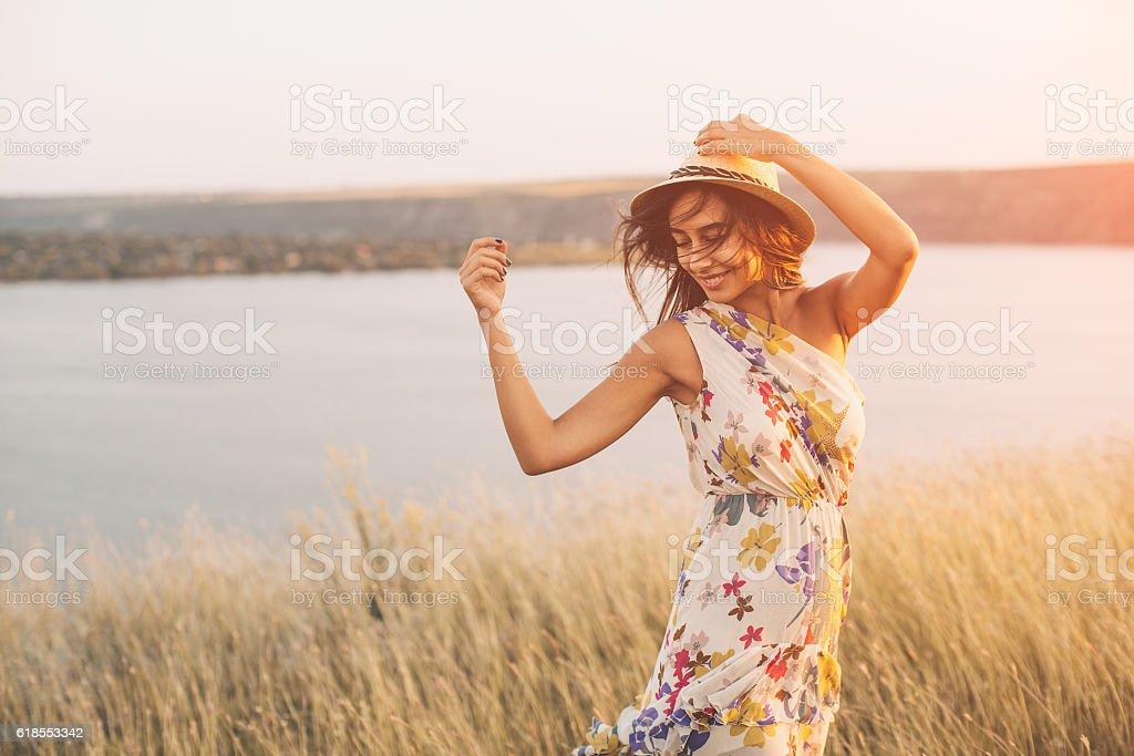 Beauty young girl outdoors enjoying nature - Photo