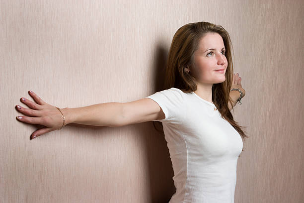 Beauty young woman leaned on wall. stock photo
