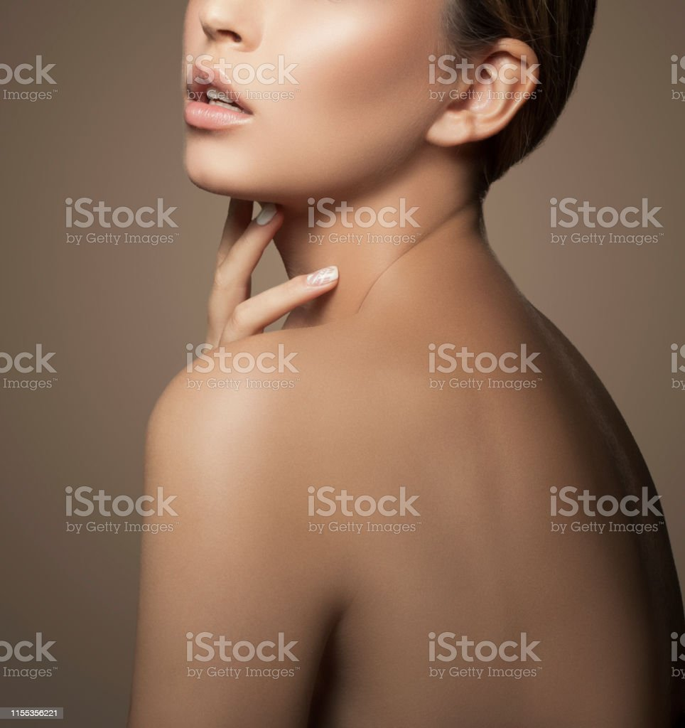 Lips, hand, shoulder of beautiful girl. Natural lips, nude make-up,...