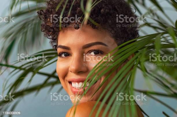 Beauty young woman smiling through palm leaves picture id1134000326?b=1&k=6&m=1134000326&s=612x612&h= ii7 rphqtcc1jeth7zj8izutrwn lyqzwkxggsqs34=