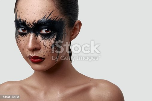 istock Beauty young Woman with Halloween creative Makeup 519316428