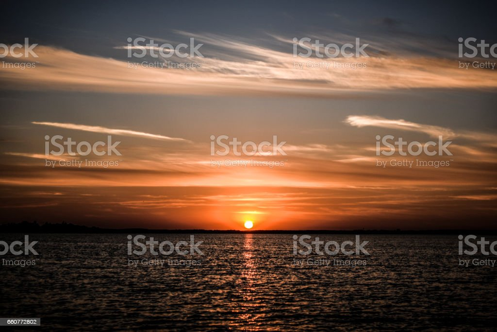 Beautyful sunset with clouds on the sky by the bea, Poland. stock photo