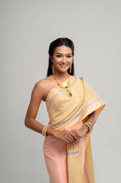 Beautyful Thai woman wearing Thai dress and smile stock photo