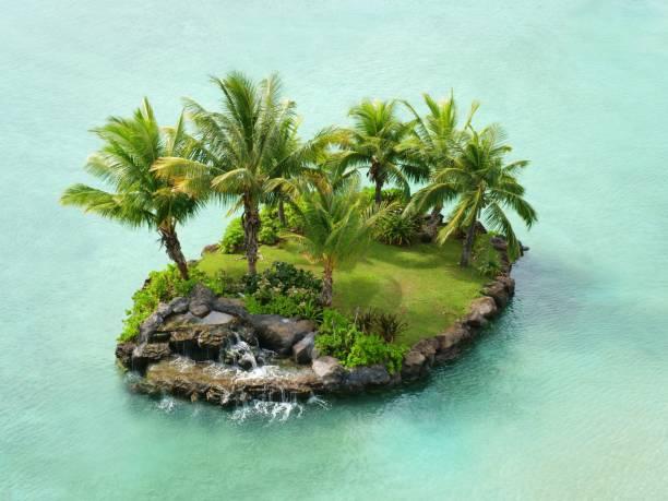 beautyfull desert island on water - desert island stock photos and pictures