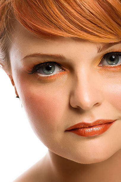 beauty/lifestyle shot - woman green eyes red hair stock photos and pictures