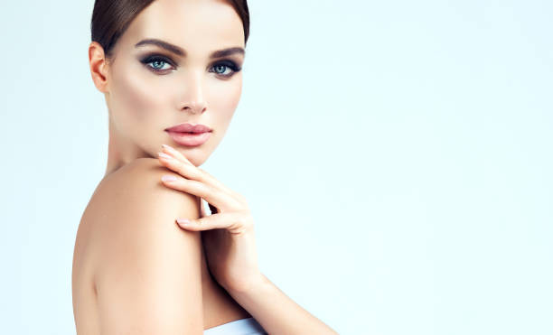 Beauty-style portrait of appealing, young woman. Makeup and beauty technologies. stock photo