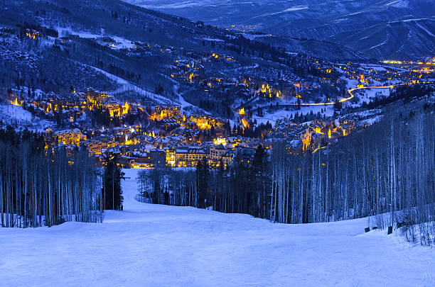 Beaver Creek Colorado Village at Dusk Scenic view from ski slopes looking down on glowing village at dusk with cool blue light and warm glowing lights.  Looking down ski runs with mountain views.  Captured as a 14-bit Raw file. Edited in 16-bit ProPhoto RGB color space. beaver creek colorado stock pictures, royalty-free photos & images
