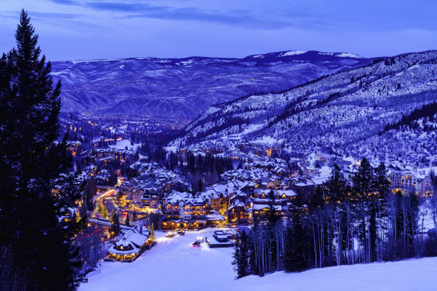 Beaver Creek Colorado Village at Night Beaver Creek Colorado Village at Night - Dusk view at twilight of village lights and town at night in winter looking down from ski slopes. avon colorado stock pictures, royalty-free photos & images