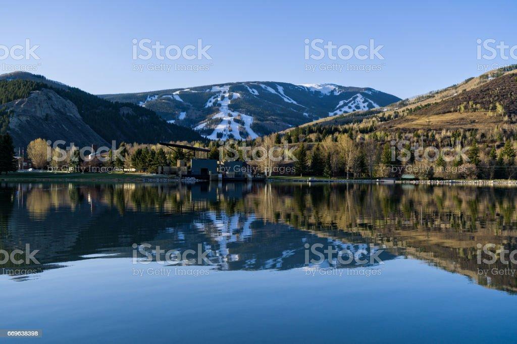 Beaver Creek Reflected in Nottingham Lake Avon Colorado stock photo