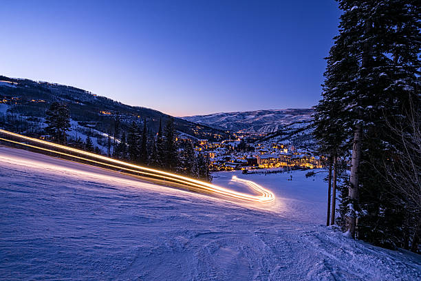Beaver Creek Resort Winter Colorado Skiing Beaver Creek Resort Winter Colorado Skiing - Scenic view with ski runs and glowing village at dusk.  Beaver Creek, Colorado USA. beaver creek colorado stock pictures, royalty-free photos & images