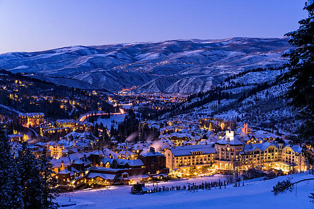 Beaver Creek Resort Winter Skiing at Dusk Beaver Creek Resort Winter Skiing at Dusk - Scenic view of village illuminated at night with ski runs. beaver creek colorado stock pictures, royalty-free photos & images