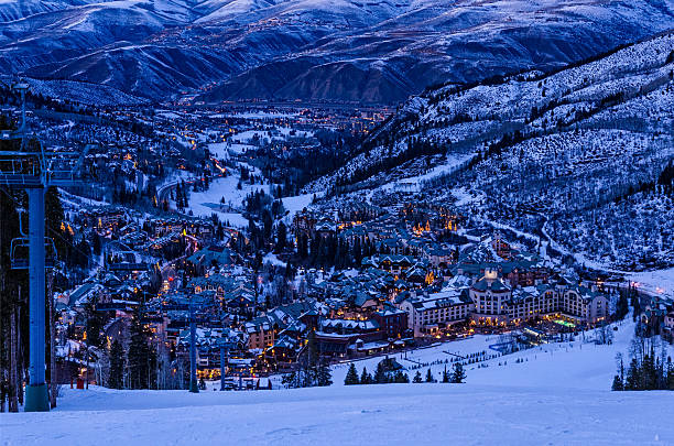 Beaver Creek Village at Dusk Beaver Creek Village at Dusk - Scenic view from ski slopes looking down with Avon, Colorado in background.  Ski resort area with town lit up in evening dusk blue light.  Beaver Creek, Colorado USA. beaver creek colorado stock pictures, royalty-free photos & images