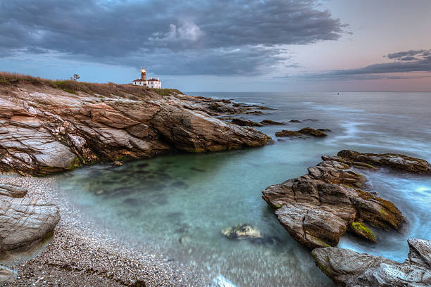 Beavertail Lighthouse at Sunset stock photo
