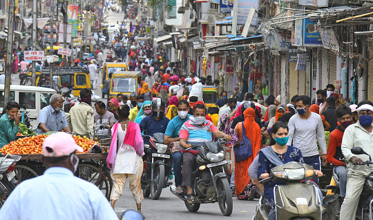 Beawar,  Rajasthan, India, April 19, 2021: People roam at the main market without maintaining social distancing, amid surge in Coronavirus cases across the country, in Beawar. Rajasthan Government declared lockdown called 'Jan Anushasan Pakhwada' (Public Discipline Fortnight) for prevention of pandemic till 3 May