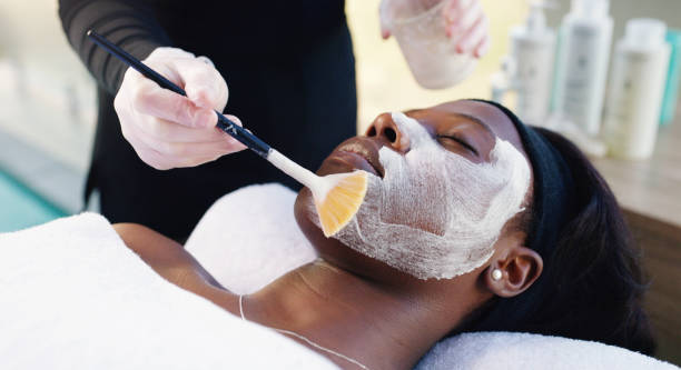 because a girl's gotta get her facial done - chemical peel stock pictures, royalty-free photos & images