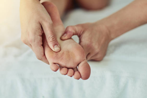 Because who doesn't love a good foot rub? stock photo
