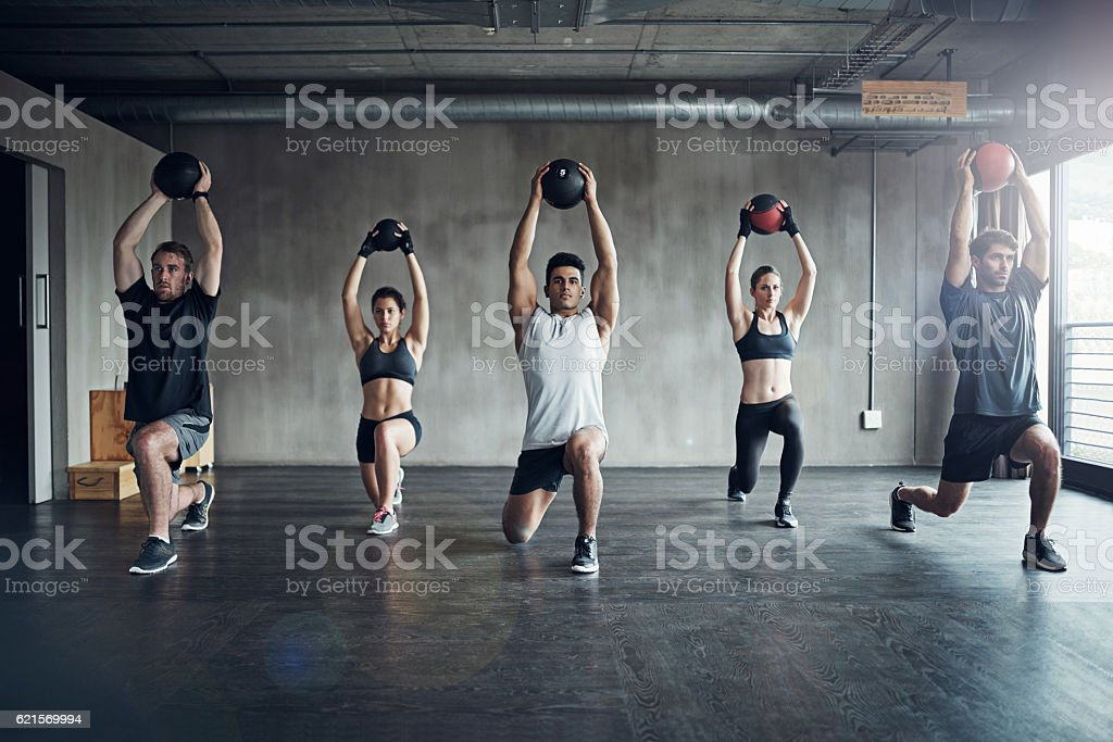 Because working out on your own can be a drag... stock photo