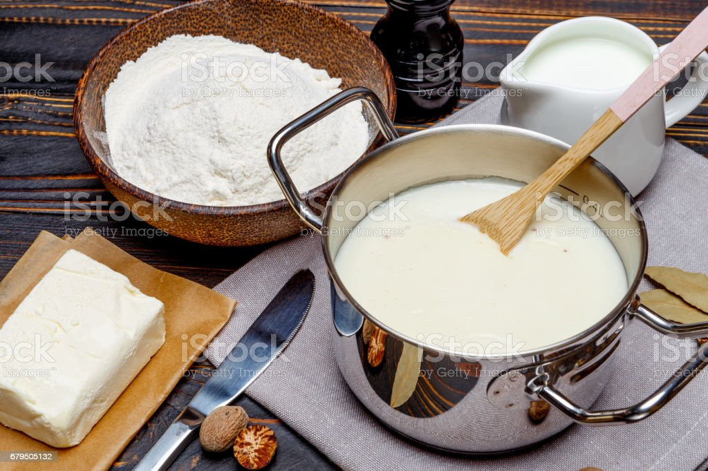 bechamel sauce in a pan and ingredients royalty-free stock photo