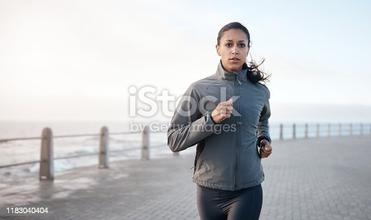 Shot of an attractive woman out for a run on the promenade