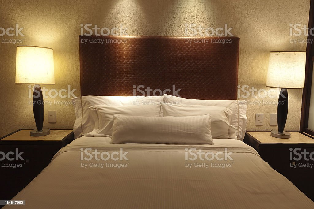 Bed and Bedding in a Hotel Room royalty-free stock photo