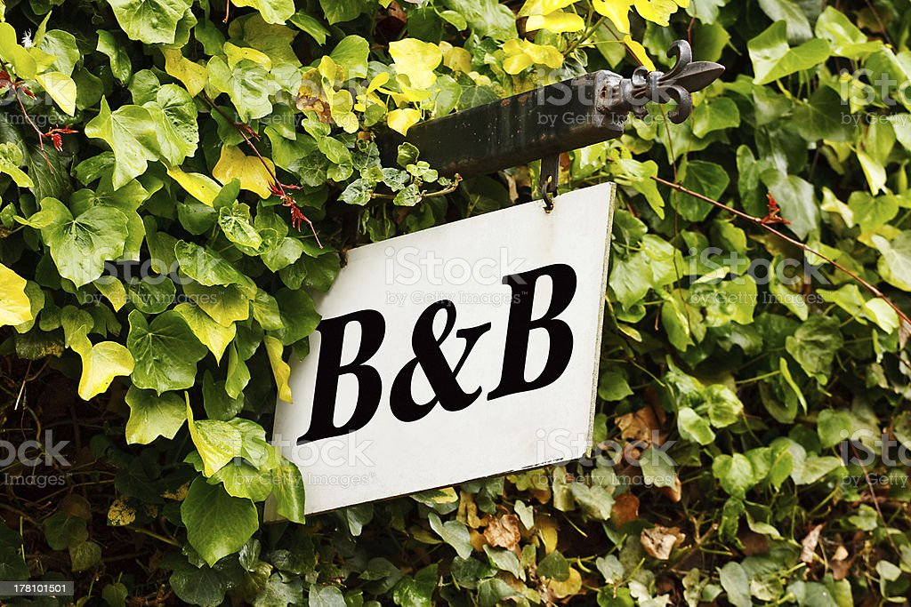 A bed and breakfast sign amongst autumn leaves stock photo