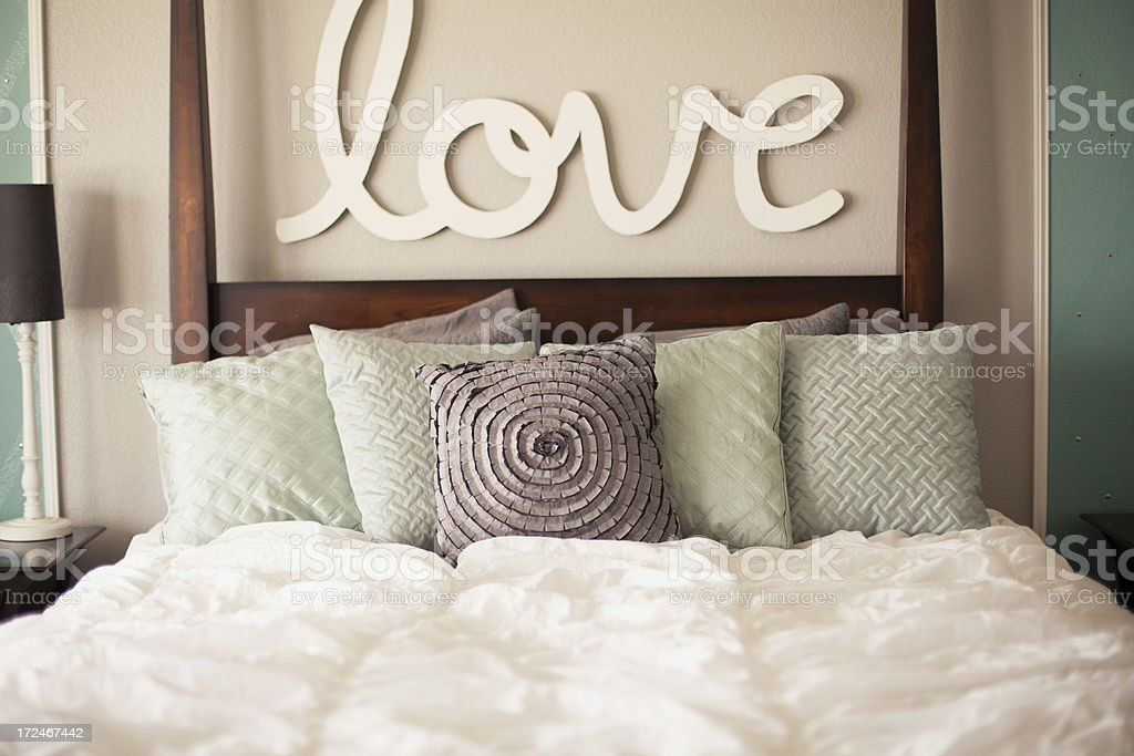 Bed and the Word Love stock photo