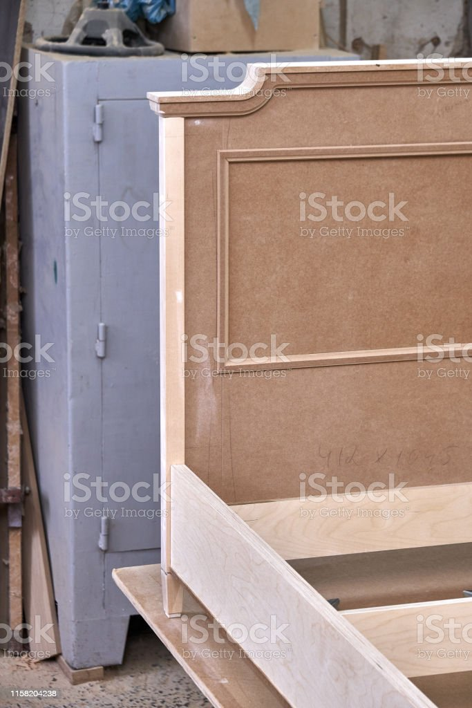 Beautiful professionally made bed of plywood and MDF in process of...