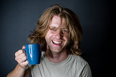 Morning coffee while this man has bead head and a bad hair day