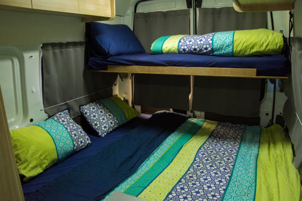 Bed in a new camper van Bed in a new camper van rv interior stock pictures, royalty-free photos & images