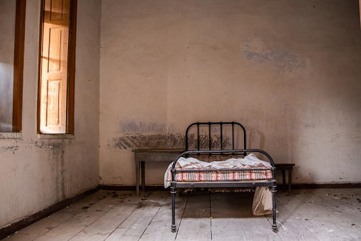A bed in an abandoned lepers' clinic