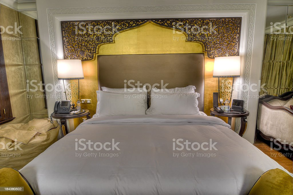 Bed in hotel room royalty-free stock photo