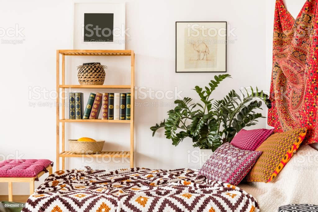 Bed in oriental bedroom stock photo