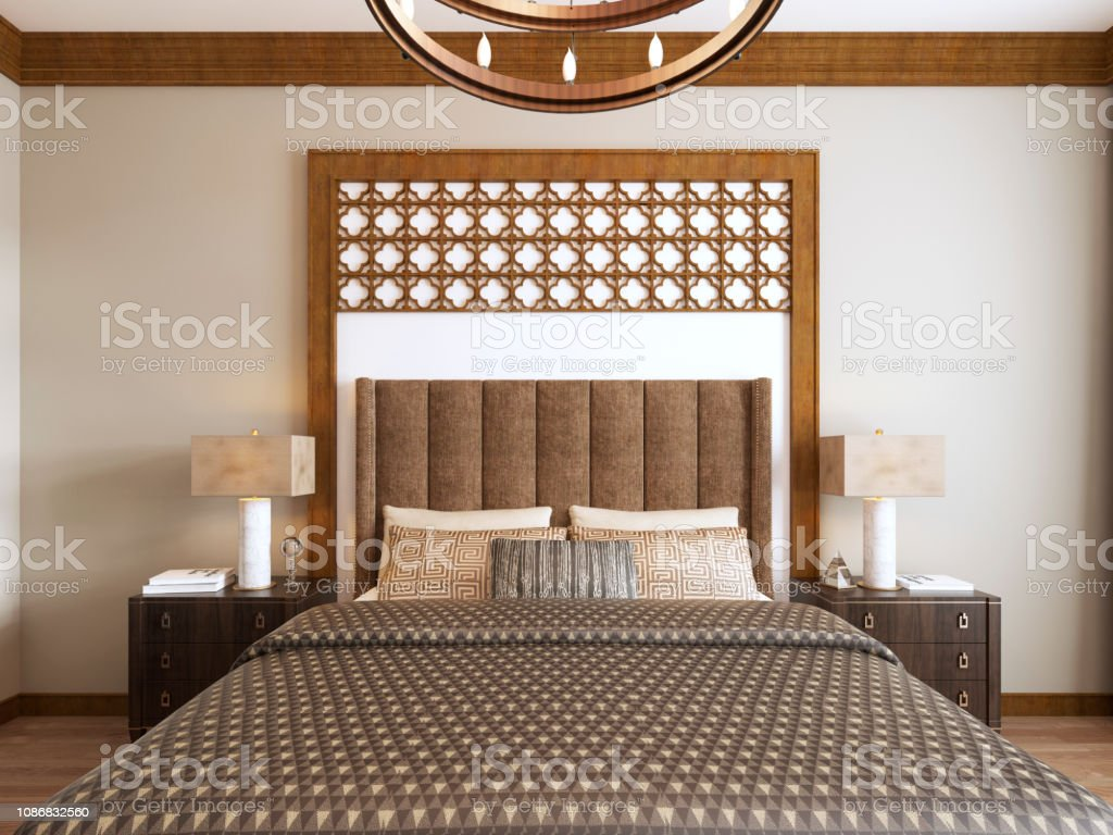 Bed in the Middle Eastern style with wooden carved headboard and bed...