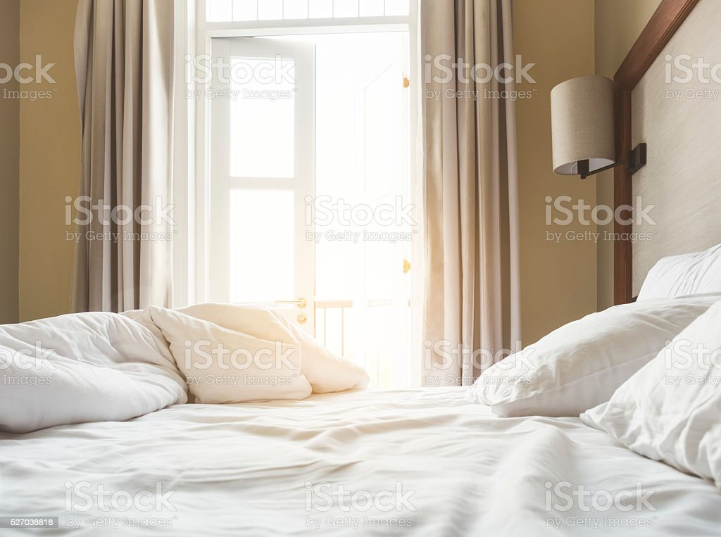 Bed Mattress and Pillows Mess up Bedroom in the morning stock photo
