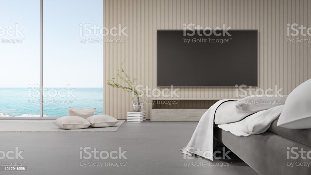 Bed On Concrete Floor Of Bright Bedroom Against Tv In Modern Beach House Or Luxury Hotel Stock Photo Download Image Now Istock