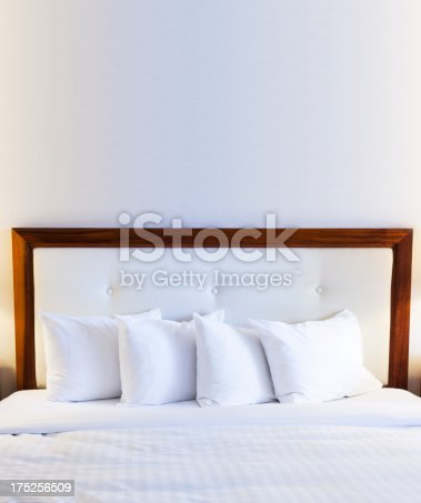 Bed with empty wall above