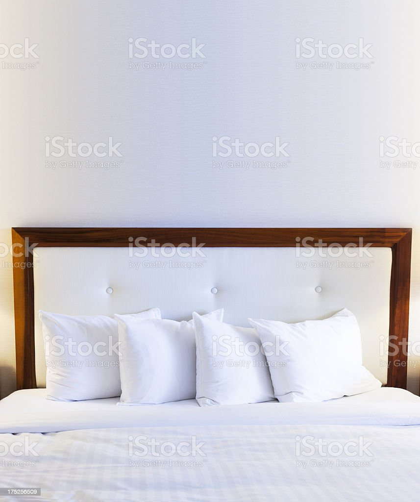 Bed on White stock photo