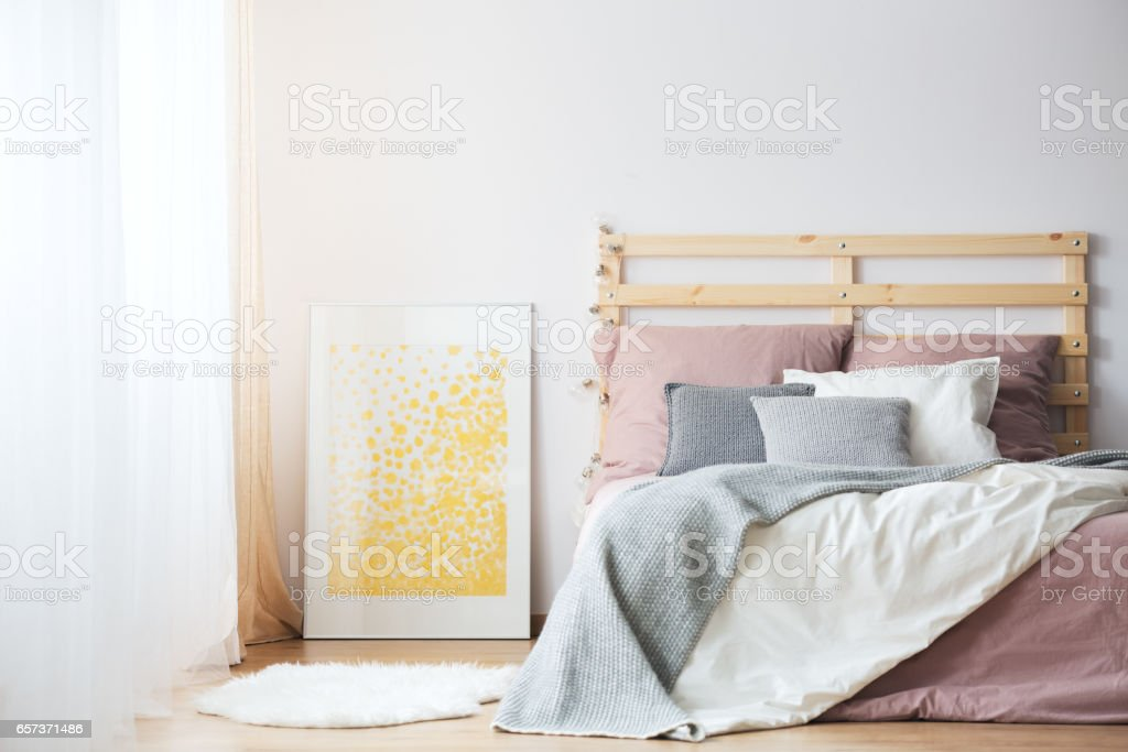 Bed, poster and rug stock photo