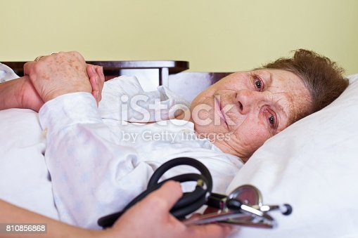 istock Bed ridden elderly woman 810856868