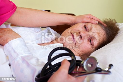 istock Bed ridden elderly woman 810856950