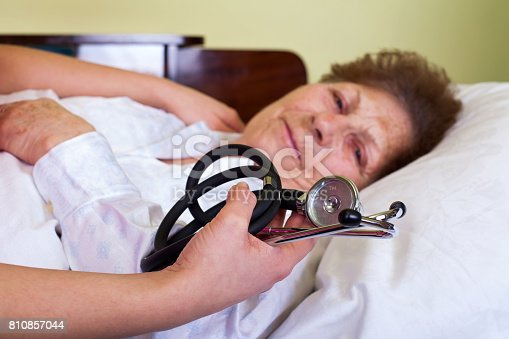 istock Bed ridden elderly woman 810857044