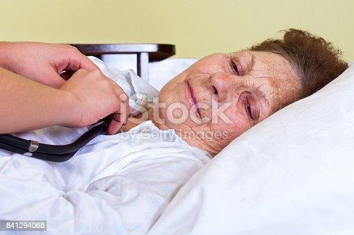 istock Bed ridden elderly woman 841294068