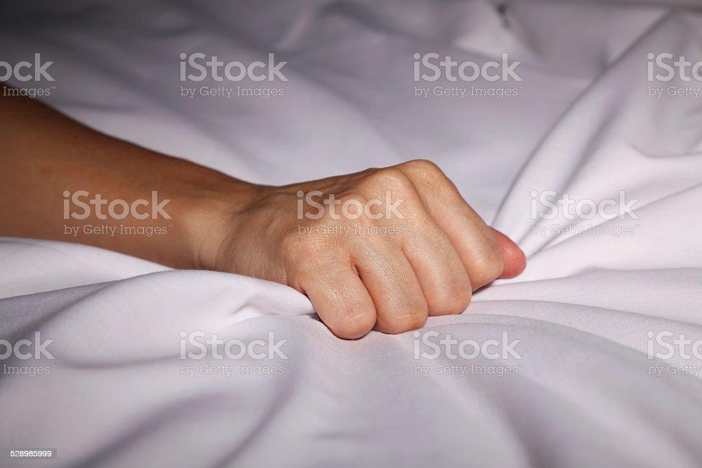 Bed sheet grabbing stock photo